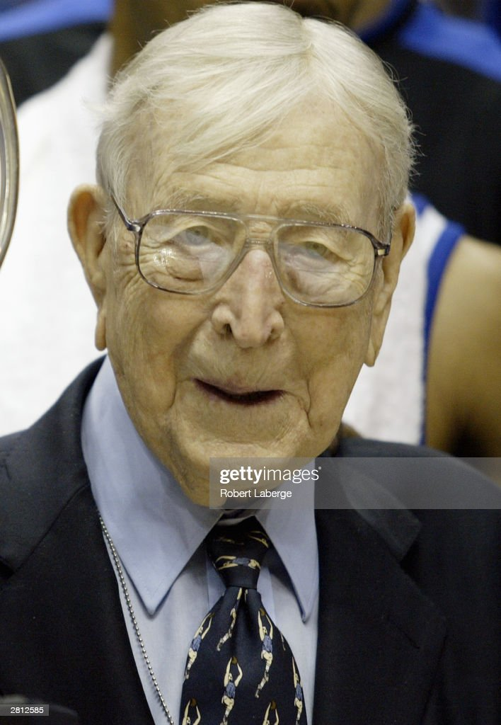 Legendary Coach John Wooden looks on after awarding head coach Tubby Smith and his Kentucky team the John R. Wooden Classic trophy after defeating UCLA 52-50 in the John R. Wooden Classic on December 6, 2003 at the Arrowhead Pound in Anaheim, California.