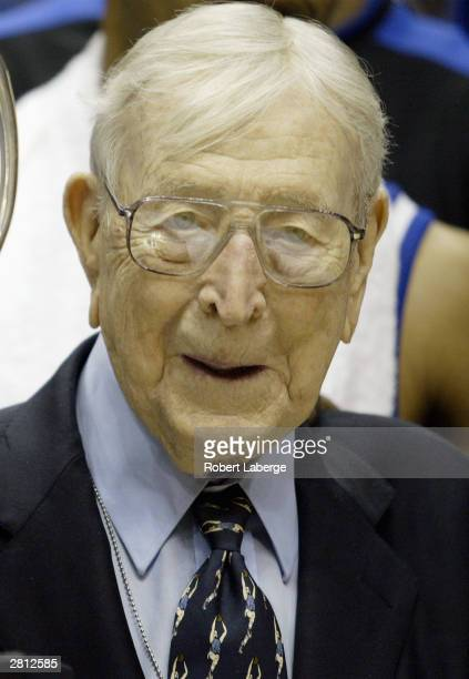 Legendary Coach John Wooden looks on after awarding head coach Tubby Smith and his Kentucky team the John R Wooden Classic trophy after defeating...