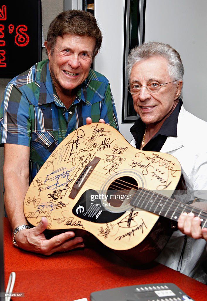 Legendary DJ Bruce 'Cousin Brucie' Morrow poses with singer Frankie Valli at the SiriusXM Studio on August 29, 2012 in New York City.