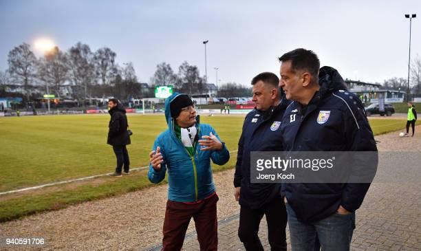 Legendary goalkeeper Eike Immel header finance of TSV Eintracht Stadtallendorf Wolfgang Schratz and host Wigald Boning and are seen on set at TSV...