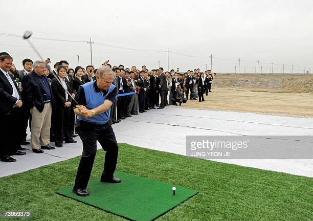 Legendary golfer Jack Nicklaus of the US hits a drive on a makeshift driving range during a ceremony to christen a golf course called the Jack...