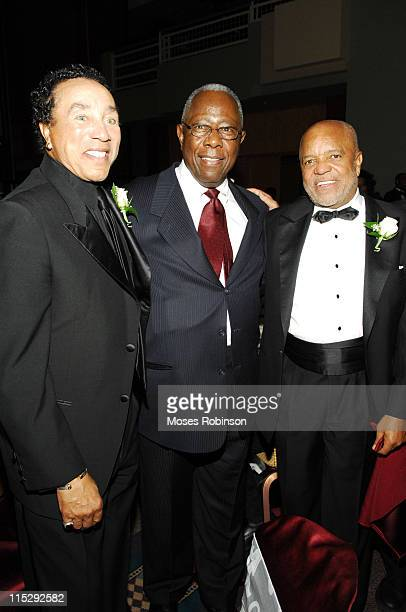 Legendary Grammy Award winning recording artist and producer Smokey Robinson Baseball Hall Of Fame Player Hank Aaron and Founder or Motown Records...