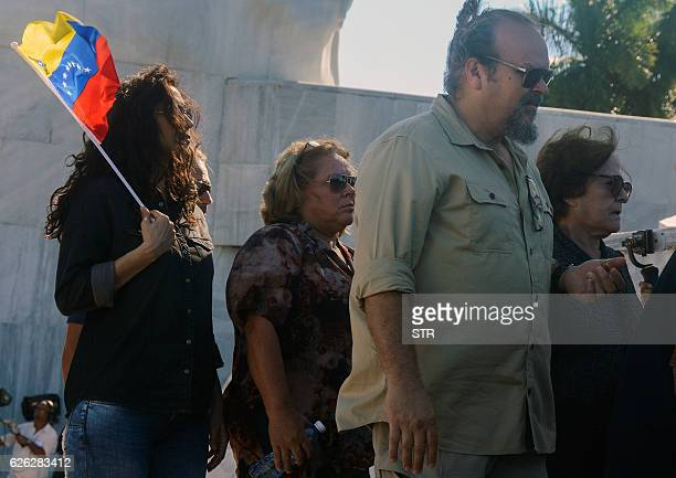 Legendary guerrilla leader Ernesto 'Che' Guevara's widow Aleida March his son Camilo Guevara and her daughter Aleida Guevara pay their last respects...
