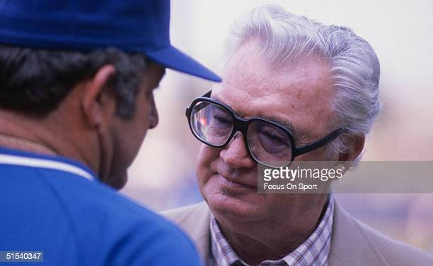 Legendary Harry Caray radio broadcaster and announcer for the Chicago White Sox until 1981 and Chicago Cubs until his death in 1998 talks to a player...
