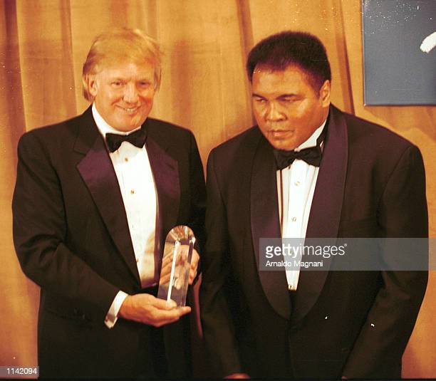 Legendary heavyweight boxing champ Muhammad Ali receives award from Donald Trump March 14 2001 in New York City Ali was honored at the 46th Annual...