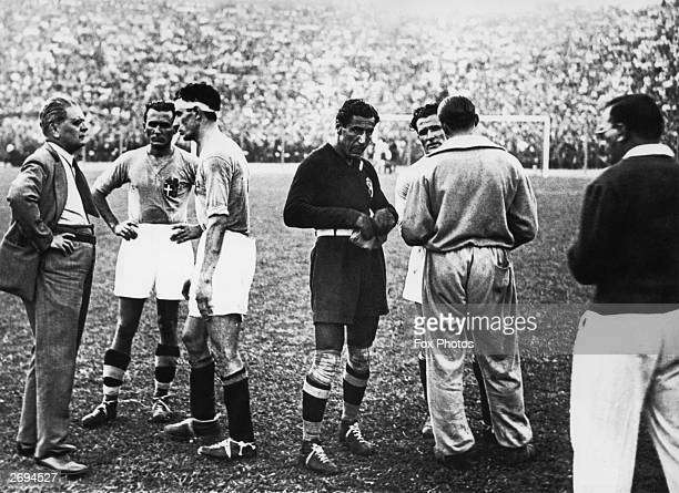 Legendary Italian manager Vittorio Pozzo talking with his players before a period of extratime after the first ninety minutes of the World Cup final...