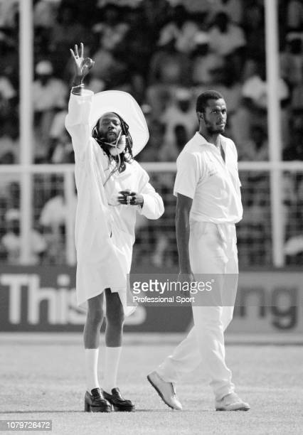 Legendary local cricket fan 'Gravy' with West Indies fast bowler Courtney Walsh during the 5th Test match between the West Indies and Australia at...