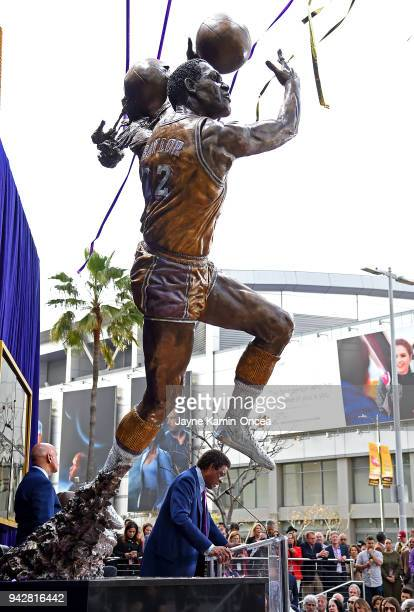 Legendary Los Angeles Lakers and NBA Hall of Fame player Elgin Baylor speaks at a ceremony for the unveiling of his bronze statue in Star Plaza at...