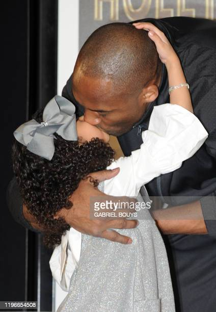 Legendary Los Angeles Lakers shooting guard Kobe Bryant and daughter Natalia Gianna MariaOnore attend his hand and footprint ceremony at the Graumans...