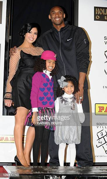 Legendary Los Angeles Lakers' shooting guard Kobe Bryant attends with his wife Vanessa and daughters Natalia Diamante and Gianna MariaOnore his hand...