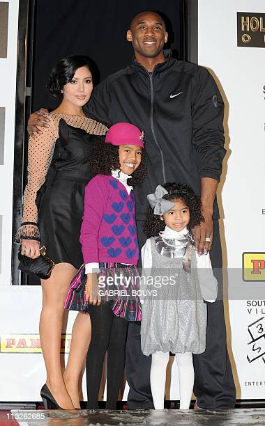 Legendary Los Angeles Lakers' shooting guard Kobe Bryant attends with his wife Vanessa and daughters Natalia Diamante and Gianna MariaOnore his...