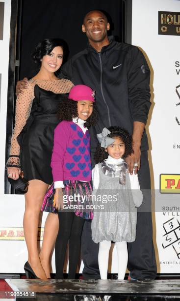 Legendary Los Angeles Lakers shooting guard Kobe Bryant attends with his wife Vanessa and daughters Natalia Diamante and Gianna MariaOnore his hand...