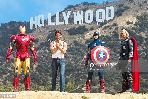 Legendary MARVEL superheroes conquer the iconic Hollywood sign to announce all new MARVEL superheroes 4D experience to open at Madame Tussauds...