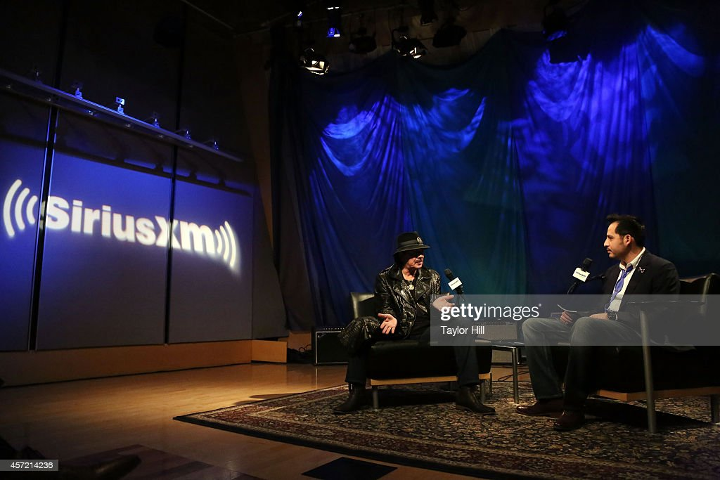 Legendary Musician Carlos Santana is interviewed by SiriusXM host Israel Salazar for 'SiriusXM ICONOS with Carlos Santana' on October 14, 2014 in Washington, DC.