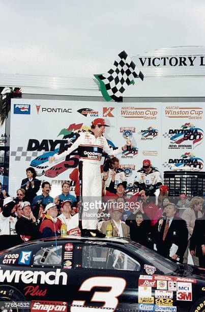 Legendary NASCAR driver Dale Earnhardt stands atop his Childress Racing Chevy and the racing world after winning the 1998 Daytona 500 The win ended...