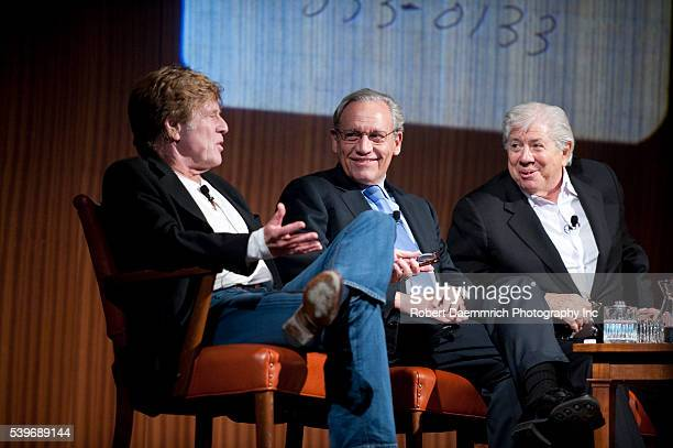 Legendary newsmen Bob Woodward and Carl Bernstein listen to a question from actor Robert Redford during a panel discussion on Watergate in...