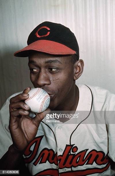 Legendary pitcher Leroy Paige, known as Satchel Paige, kisses a ball of the sport that made him famous.