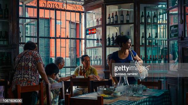 legendary queirolo restaurant bar in the historic center of the city of lima - pisco peru stock photos and pictures
