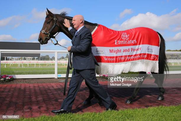 Legendary race caller Greg Miles who will call his final race meeting at Caulfield on Saturday walks with Might and Power in the mounting yard at...