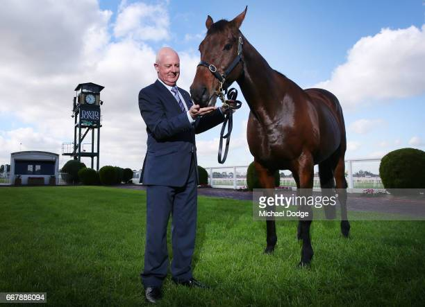 Legendary race caller Greg Miles who will call his final race meeting at Caulfield on Saturday poses with Might and Power at Caulfield Racecourse on...