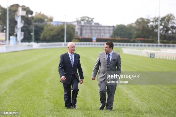 Legendary race caller Greg Miles who will call his final race meeting at Caulfield on Saturday and fellow race caller Matthew Hill walk down the...
