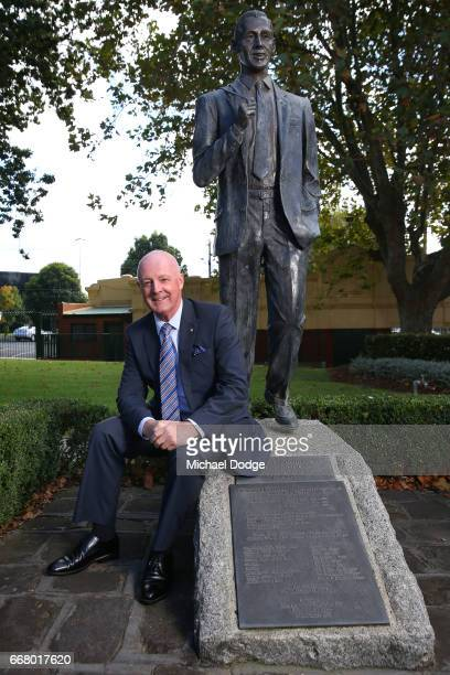 Legendary race caller Greg Miles who will call his final race meeting at Caulfield on Saturday poses next to the Bill Collins Statue at Caulfield...
