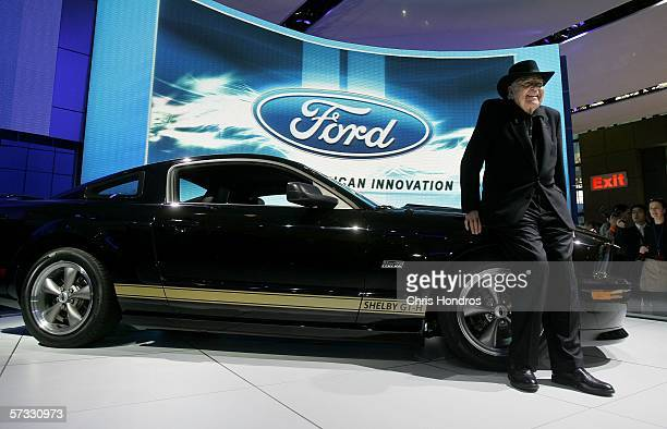 Legendary race car driver and designer Carroll Shelby poses with the 2007 Ford Shelby Mustang GTH April 12 2006 during the press preview of the 2006...