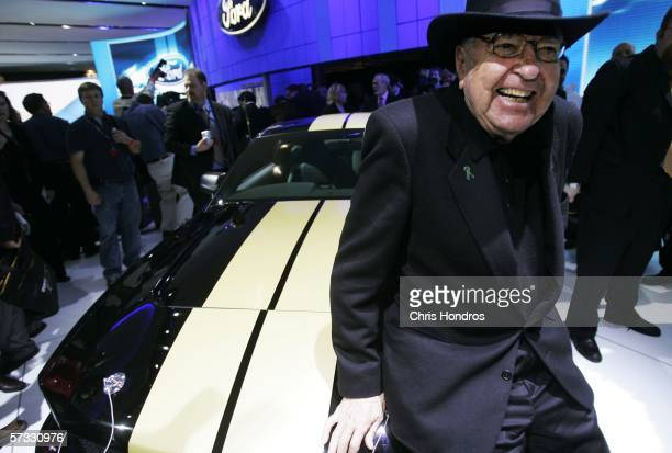 Legendary race car driver and designer Carroll Shelby poses with the 2007 Ford Shelby Mustang GT-H April 12, 2006 during the press preview of the...