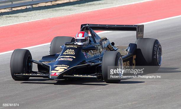 Legendary race car driver Mario Andretti takes the first lap in a Formula One car on the new Circuit of the Americas track outside Austin on Sunday....