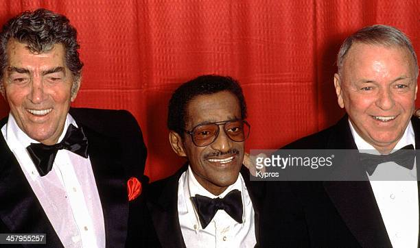 Legendary 'Rat Pack' entertainers Dean Martin Sammy Davis Jr and Frank Sinatra pose for photos at a press conference announcing their 1988 'Together...