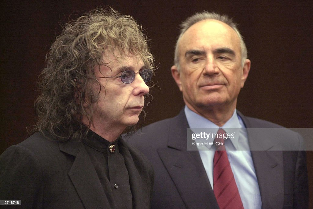 Legendary record producer Phil Spector (L) and attorney Robert Shapiro appear in Alhambra Superior Court for Spector's arraignment on one count of murder November 20, 2003 in Alhambra, California. Spector is charged with murdering B-movie starlet Lana Clarkson at his hilltop mansion Februay 3. Spector, the 1960s recording-studio wizard who created the ``Wall of Sound'' style of recording and worked with such stars as The Beatles, The Ronettes and Ike and Tina Turner, pleaded innocent at the arraignment.
