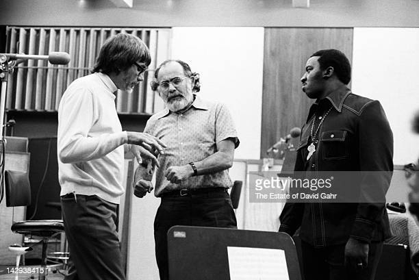 Legendary record producers Tom Dowd and Jerry Wexler confer while recording Aretha Franklin at Atlantic Records Studios in April 1973 in New York...