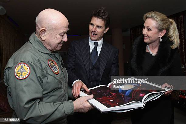 Legendary Russian astronaut Alexey Leonov presents to Tom Cruise his book before the film premiere of 'Oblivion' at the Oktyabr cinema hall on April...