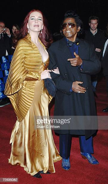 Legendary soul singer James Brown arrives with Tomi Rae Hynie at the UK Music Hall Of Fame 2006 at Alexandra Palace on November 14 2006 in London...