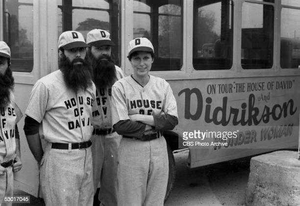 Legendary sportswoman Mildred 'Babe' Didrikson Zaharias poses with two members of the House of David baseball team while traveling as their featured...