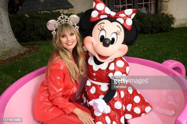 Legendary supermodel, television host and entrepreneur Heidi Klum embraces global star and fashion icon Minnie Mouse on Sept. 28 at Disneyland in...