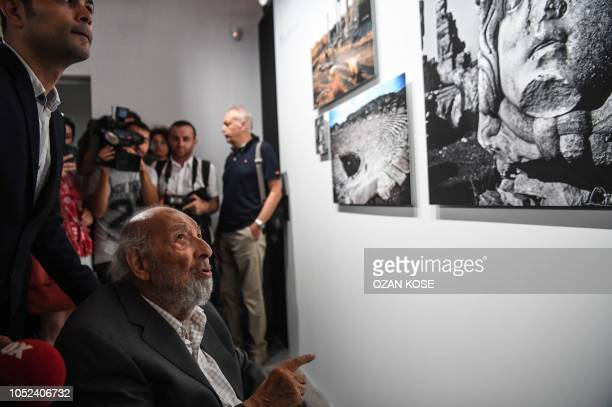 Legendary Turkish photographer Ara Guler , looks to his exhibition on August 16, 2018 during at the opening of Ara Guler museum in Istanbul. -...