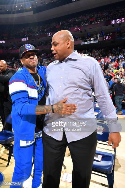 NBA legends Allen Iverson and Charles Barkley attend Moses Malone's jersey retirement ceremony during the game between the Denver Nuggets and the...