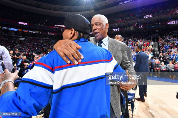 NBA legends Allen Iverson and Julius Erving attend Moses Malone's jersey retirement ceremony during the game between the Denver Nuggets and the...