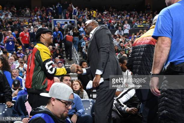 NBA legends Allen Iverson and Magic Johnson shake hands during the game between the Los Angeles Lakers and the Philadelphia 76ers on February 10 2019...