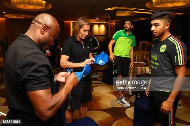 Legends and Emmanuel Amunike and Michel Salgado autograph bone for Deivoon Magaa of Mexico during a FIFA Ethics Workshop ahead of the FIFA U-17 World...