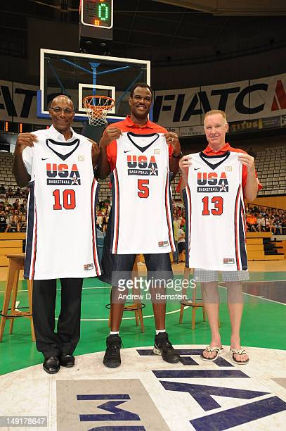 Legends and former 1992 Dream Team members Clyde Drexler David Robinson and Chris Mullin pose with their old jerseys at the arena in Badalona Spain...