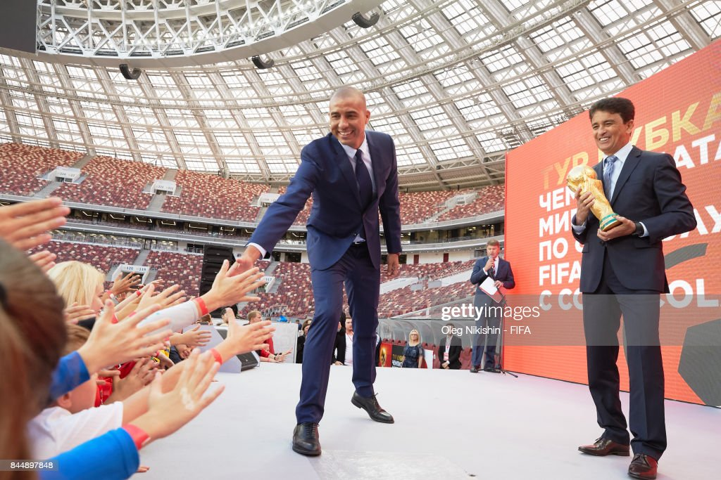 Legends Bebeto and David Trezeguet stay with a Troph during official kickoff event FIFA World Cup Trophy Tour at Luzhniki stadium on September 9, 2017 in Moscow, Russia.
