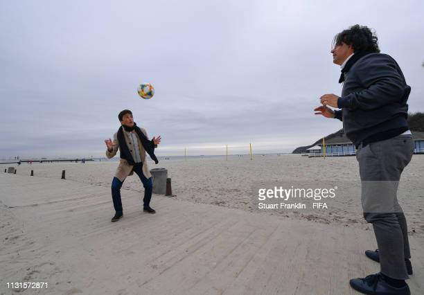 Legends Bebeto of Brazil and Fernando Couto of Portugal play with the official FIFA U20 World Cup match ball on the beach prior to the official draw...