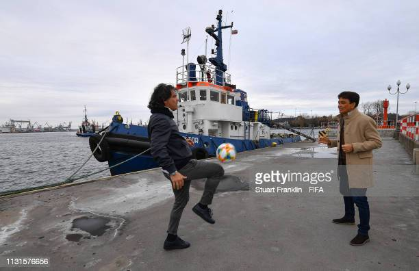 Legends Bebeto of Brazil and Fernando Couto of Portugal play with the official FIFA U20 World Cup match ball by the harbour prior to the official...