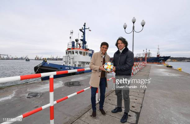 Legends Bebeto of Brazil and Fernando Couto of Portugal pose with the official FIFA U20 World Cup match ball by the harbour prior to the official...