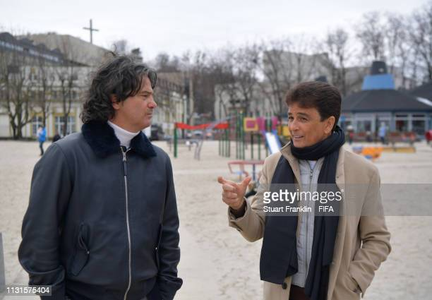 Legends Bebeto of Brazil and Fernando Couto of Portugal walk on the beach prior to the official draw on February 23 2019 in Gdynia Poland