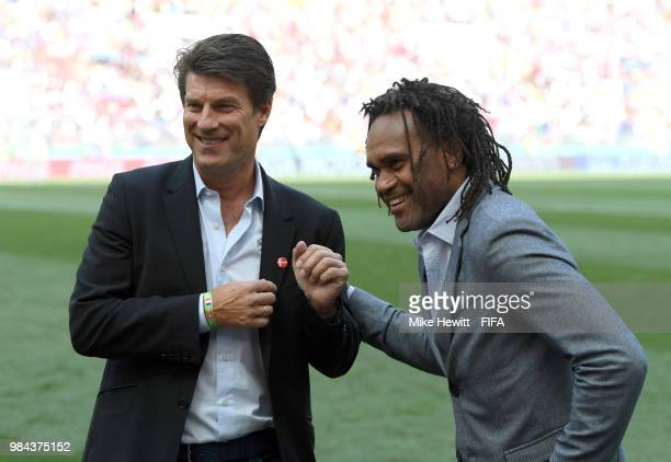 Legends Brian Laudrup and Christian Karembeu shake hands prior to the 2018 FIFA World Cup Russia group C match between Denmark and France at Luzhniki...