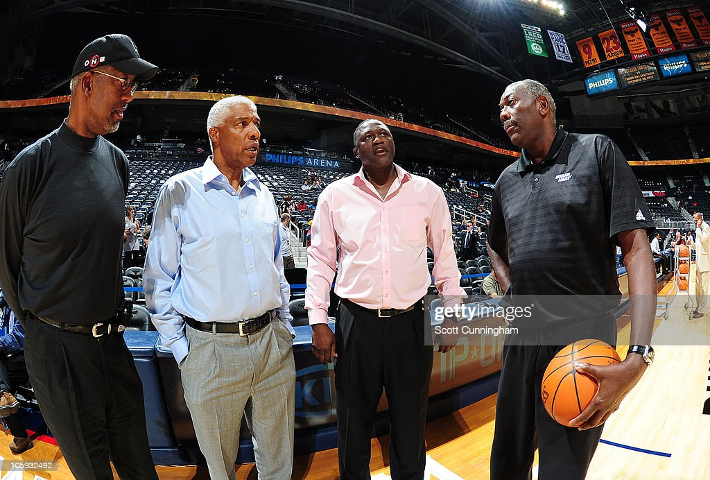 NBA Legends Dan Roundfield, Julius Erving, Dominique Wilkins, and Bob McAdoo (L-R) chat before the game between the Atlanta Hawks and the Miami Heat on October 21, 2010 at Philips Arena in Atlanta, Georgia.