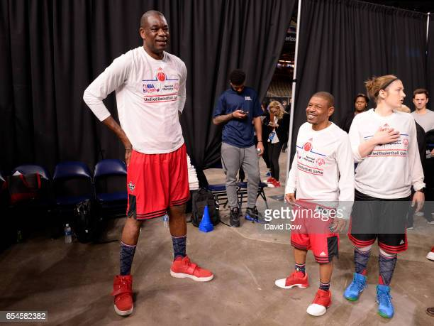 Legends Dikembe Mutombo and Muggsy Bogues get ready before the NBA Cares Special Olympics Unified Sports Game as part of 2017 AllStar Weekend at the...